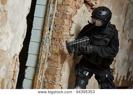 Military industry. Special forces or anti-terrorist police soldier,  private military contractor armed with weapon during clean-up operation, mission