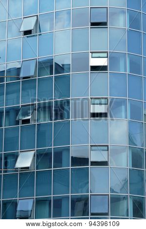 Reflection In Windows Of Modern Office Building