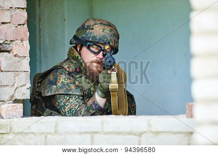 military. soldier targeting  with assault rifle at position in nato germany uniform indoors