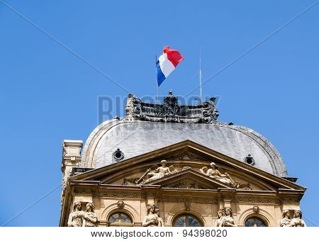 Flag Of France Over Historic Building.