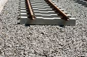 image of tram  - The construction of a railway line for a tram with rails gravel and underlay sleepers - JPG
