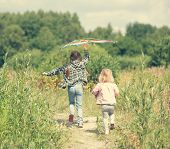 pic of kites  - little cute girls flying a kite in a meadow on a sunny day - JPG