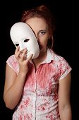 pic of female mask  - female zombie with halloween mask and bloody shirt - JPG