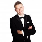 stock photo of tuxedo  - young elegant smiling man in tuxedo isolated on white - JPG
