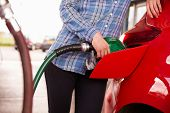 stock photo of petrol  - Refuelling a car at a petrol station - JPG