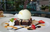 stock photo of ice-cake  - A rich dessert made from chocolate brownie cake and vanilla ice cream - JPG