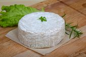 picture of brie cheese  - Camembert brie cheese with herbs on the wood background - JPG