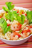 stock photo of celery  - Italian salad made of fusilli shrimp celery decorated with celery leaves - JPG