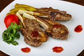 stock photo of lamb chops  - Grilled Lamb chops with eggplant and coriander leaves - JPG