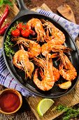 picture of tiger prawn  - Fried king prawns on iron pan - JPG