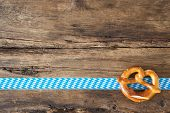 picture of pretzels  - Pretzel on old wooden background for Oktoberfest - JPG