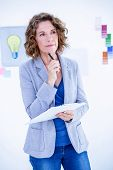 pic of thoughtfulness  - Thoughtful creative businesswoman looking away in office - JPG