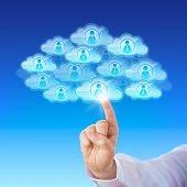 picture of peer  - Index finger of a white collar worker is touching a cloud icon to connect with many peers in cyberspace - JPG
