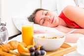picture of bed breakfast  - breakfast on a tray beside the bed sleeping girl - JPG