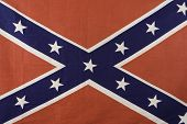stock photo of confederation  - isolated red and blue cloth confederate battle flag - JPG