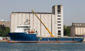 image of silos  - Ship in front of a Port Silo  - JPG