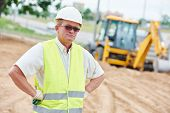 stock photo of millwright  - adult construction site manager worker at roadwork area - JPG
