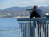 picture of observed  - Man Exploring the Pacific Ocean From Observation Deck Telescope - JPG