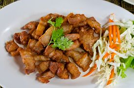 stock photo of pork belly  - Fried pork belly with fish sauce a Thai cuisine - JPG