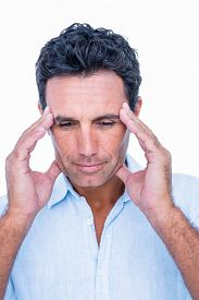 stock photo of forehead  - Handsome man thinking with hand on forehead on white background - JPG