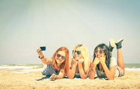 pic of selfie  - Happy girlfriends taking a selfie at beach  - JPG