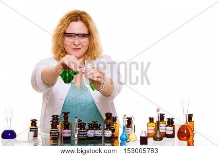 Experiments in laboratory. Chemist woman or student girl scientific researcher with chemical bottles test flask. Isolated on white