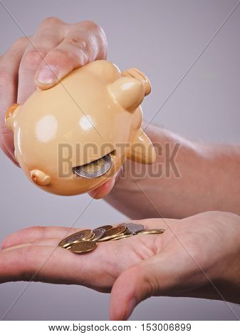 Spending money concept. Male hands with coins of polish zloty pln. Savings.