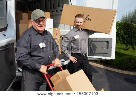 Group of delivery man with a parcel.