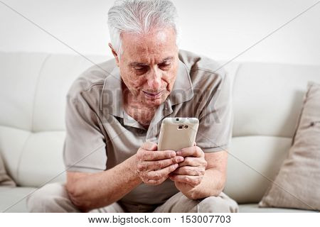 Senior man with smartphone.