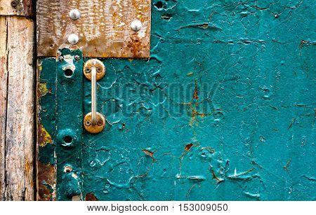 The old vintage wooden doors with doorknob, seagreen colour