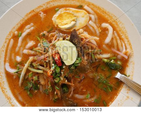 Laksa, Malaysian dish consisting of rice noodles served in a curry sauce