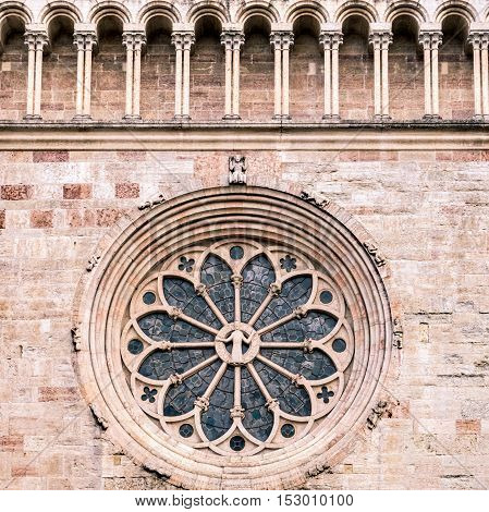 Trento Cathedral. Detail of the rosette said wheel of fortune for the represented iconographic motif.