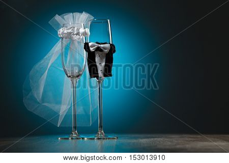 Two wineglass with special decoration for wedding ceremony