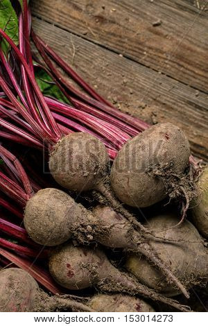 Beets on wooden background