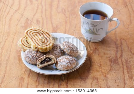 Roll cakes and tea on the saucer near
