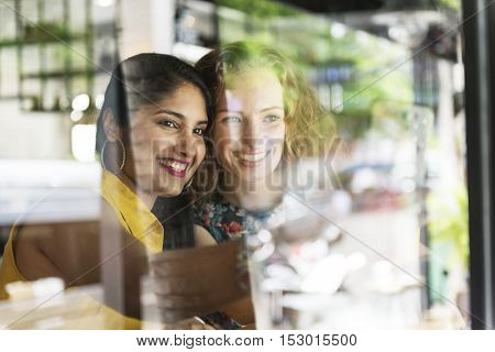 Young Women Taking Pictures Concept