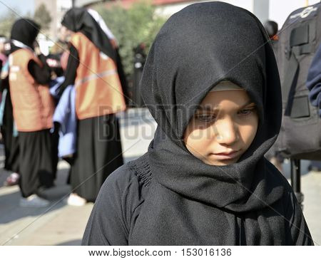 Istanbul Turkey - October 11 2016: Worldwide day of Ashura and Children. Turkish Shia Muslims mourning for Imam Hussain. Caferis take part in a mourning procession marking the day of Ashura in Istanbul's Kucukcekmece district Turkey on October 11 2016.