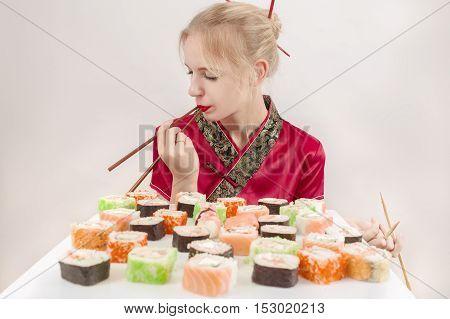fun girl with sushi on white background, toned image