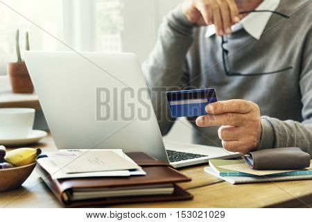 Senior Adult Holding Credit Card Concept