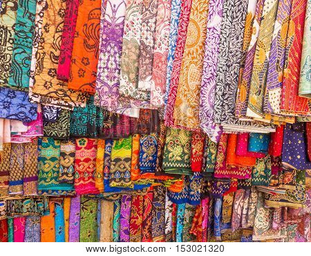 Colorful sarongs on sale in the market at Ubud in Bali, Indonesia.