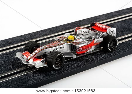 Moscow Russia - Aug 14 2010: Slot car racing track with silver formula one car.