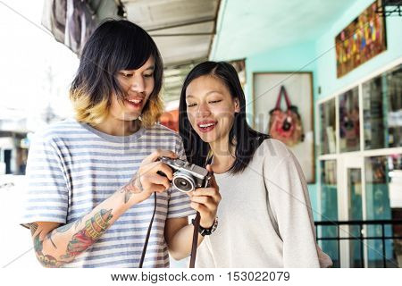 Couple Checking Photos Camera Concept