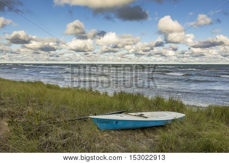 Sailboat pulled up into dune grass on the shore of Lake Huron - Ontario Canada