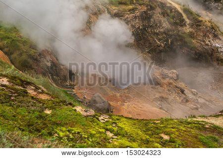 Eruption Bolshoy Big Geyser in Valley of Geysers. Kronotsky Nature Reserve on Kamchatka Peninsula.