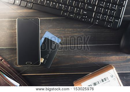 smart phone on credit card with wallet and online shopping product.