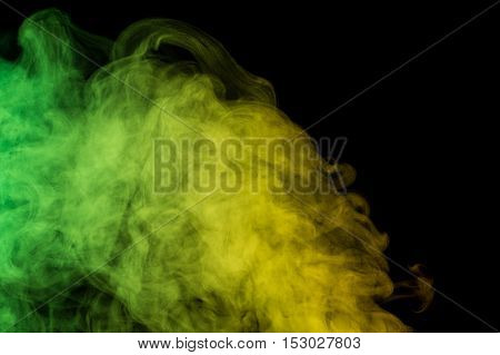 Abstract green yellow water vapor on a black background. Texture. Design elements. Abstract art. Steam the humidifier. Macro shot.