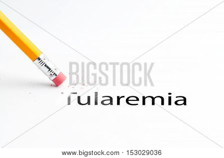 Closeup of pencil eraser and black tularemia text. Tularemia. Pencil with eraser.