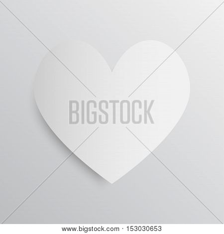 White paper heart on a gray background.