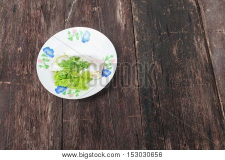 Fresh Spring Roll with vegetable and coriander in plateThailand food on the wooden table top view