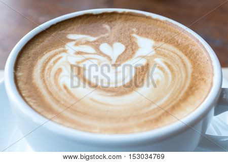 Close up of Latte art on the surface of a cup of coffee.